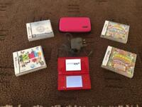 Red Nintendo Dsi console and games