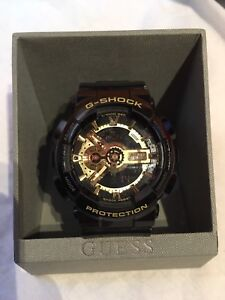 Black and gold gshock watch