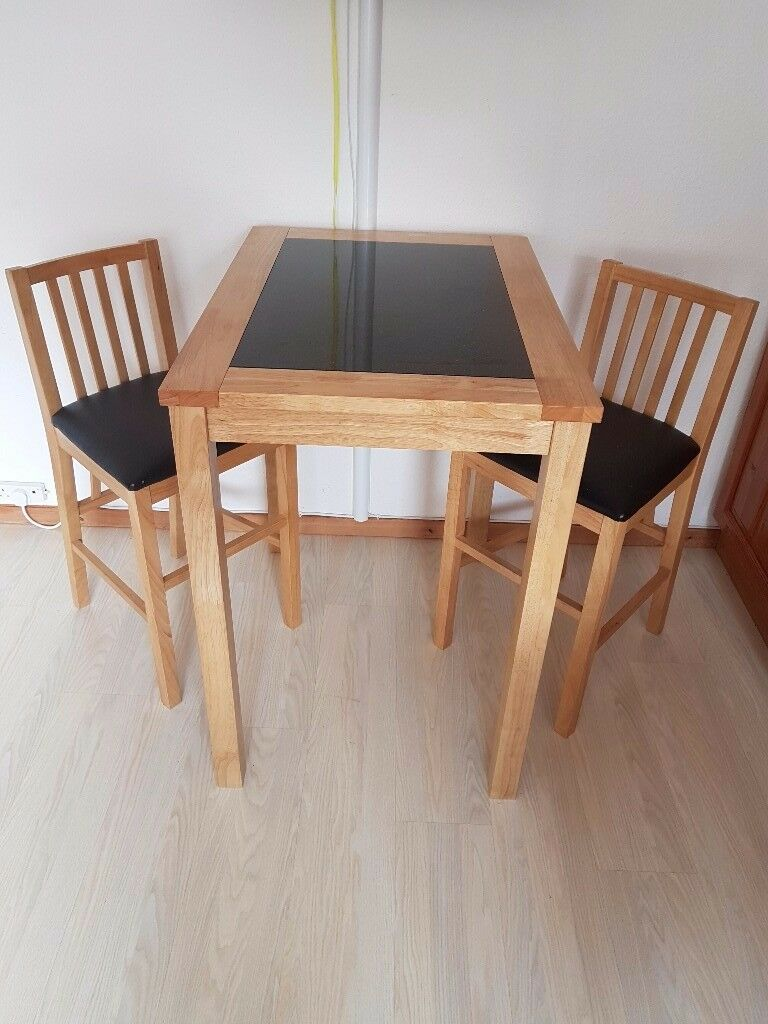 a lovely 2 seat high kitchen/dining bar table with a granite