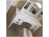 White vintage double bed frame with matching dressing table and seat