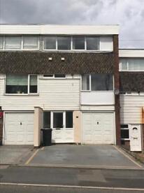 A four bedroom town house with garage, garden in Halesowen Quinton Hurst Green