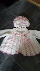 Baby girls pink/white knitted cardigan and hat
