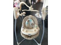 Rocking Baby cradle,chair has a one hand recline system, multi speed setting