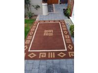 LOVELY BROWN RUG GREAT CONDITION.