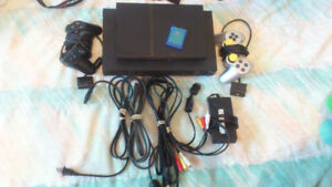 2 PS2 + 2 manettes + 1 memory card
