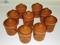 Terracotta storage canisters for herbs and spices.
