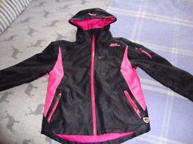 "Girls ""No Fear"" waterproof jacket in black and fushia pink"