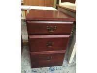 Dark bedside cabinet