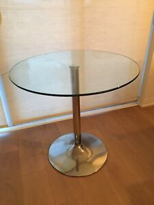 Round glass and chrome pedestal table
