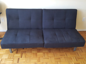 A sofa bed and a office chair