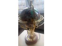 Antique brass and marble effect globe, with wooden base.