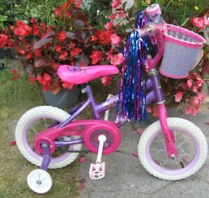 "Girls Sea Star bike by Huffy 12.5 "" tires"