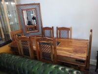 lovely large solid wood dining table and 6 chairs with machine large mirror.