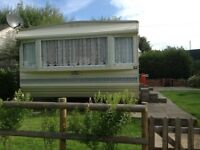Static holiday caravan for sale on small farm site