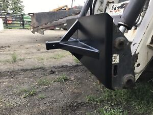 Skid steer trailer hitch adapter
