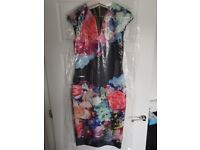 Black ted baker dress with multi coloured flowers. Size 12. Already been dry cleaned.
