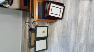 Many picture frames for sale.