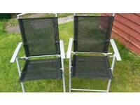 Two folding garden chairs