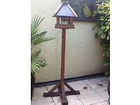 Wooden bird table with slate roof