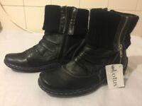 Unworn black half-boot