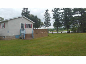 move in ready cottage with 100 ft waterfront Cocagne River