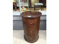 Modern Hardwood Cylindrical Chest , in good condition Size Diameter 16in height 25in Has 3 drawers.