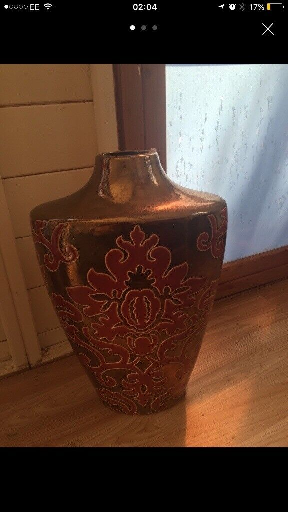 Orientalist vase gold and red, about 12 inches , heavy . Collect only
