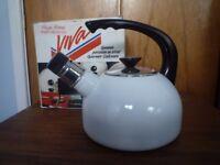 Whistling Kettle. Brand new in box. White porcelain on heavy stainless steel. 1L capacity
