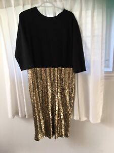 Night out dress. Black top w. Gold sequinned skirt.
