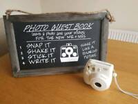 Poloroid Camera and chalk board sign with instructions