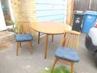 Extendable kitchen table and 4 matching chairs