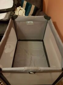 JOIE TRAVEL COT Suitable from birth and includes changing area