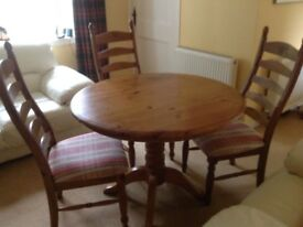 Solid wood circular pine table and 4 chairs
