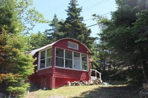 QUONSET HUT COTTAGE ON THE WATER