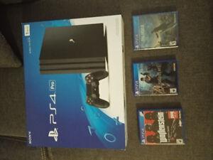 PS4 Pro comme neuve + 3 jeux pour 430$