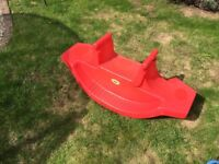 Kids red plastic seesaw