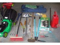 Garden tools and lawnmower.