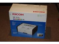 black and white laser printer Ricoh SP 213W . New in a sealed box.
