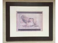 Pair of framed animal prints