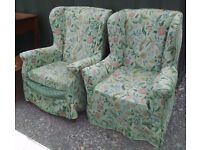Pair of winged backed armchairs