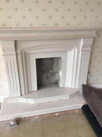 Marble fire surround with fire