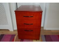 Mahogany office drawers which are sturdy and office quality/standard.