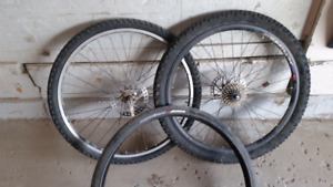Front and rear 26 inch bike wheel plus spare tire