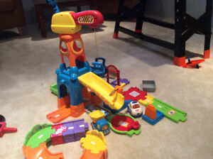 Vtech crane set comes with dump truck and police car