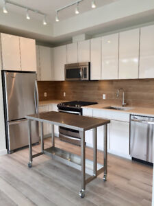 BRAND NEW condo with large outdoor living space!!