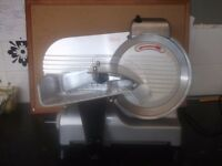 I have a Food slicer for sale. It has an 8 inch blade with manual.