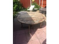 Circular wooden patio table