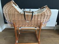 The snug Moses basket with rocking stand