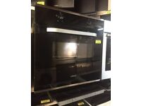 Black Cata 600mm integrated single oven with 6 months warranty