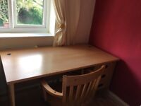 Desk with drawers and matching chair on castors. Very nice condition